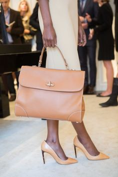 Ralph Lauren Resort 2016: RL gold saddle top handle and natural tumbled vachetta pump with tortoise heel