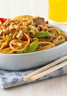 Asian Peanut Beef & Noodles for Two — Say so long to takeout. Toss snap peas and peppers with steak, noodles, and a peanut sauce for a surprisingly Healthy Living recipe.