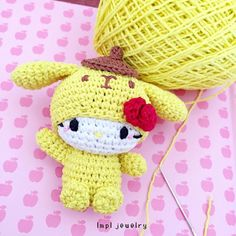 Hello Kitty dressed as Pom Purin…