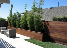 Slated & stained wood fencing & planter
