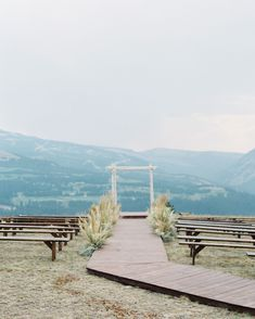 The ceremony took place on top of the Yellowstone Club's helicopter pad and featured sweeping views of the surrounding mountains; a special dried wildflower aisle. #Wedding #Venues #WeddingVenues #DestinationWedding #MountainTop #Unique #Rustic | Martha Stewart Weddings - One Couple Planned a Natural, Elegant Wedding Underneath the Montana Sky