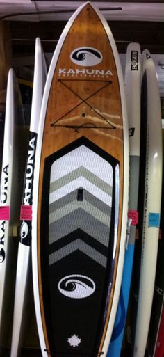 Kahuna King  11.6x33x6.65 Available in  dark koa  bamboo (not as photo) Includes carbon adjustable paddle,board bag and ankle leash  $1899
