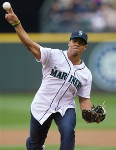 Seahawk QB Russell Wilson throws out the first pitch before the Mariners/Yankees game.