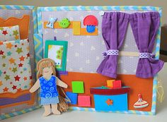 Quiet book Dollhouse with felt doll and clothes. The size of Book 23*25 cm. The book contains 50 or more removable elements. Variants of the pages of the book 1. Bedroom with wardrobe and clothes. 2. Childrens playroom with toys. 3. Bathroom. 4. Laundry with washing machine. 5.