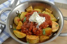 Roasted fingerlings with spicy tomato sauce and creme fraiche