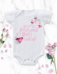 "This baby girl Onesie® bodysuit is a fun take on the Christian Bible Verse ""She is more precious than rubies"" from Proverbs 3:15. it's also the perfect baby shower gift! Shop the outfit here: https://www.etsy.com/listing/265261540/baby-girl-clothes-baby-girl-gift-baby?ref=shop_home_active_23"