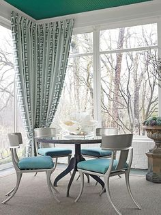 Just came to my email from BHG.com----this pic grabbed me instantly.  Has the muted/edgy/elegant/old world-modern look I like (plus a round table, sisal rug, and sort of similar chairs :)  And Greek key!!!  (not grooving on that ceiling color, though)