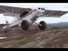 Short take off and landing (STOL) Piper Cub. 28 seconds. Way cool!!