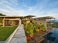 This impressive mansion is located in Phuket, Thailand. It's a big tropical villa of 560 square meters with four bedrooms and six bathrooms. The project was designed taking into account stability, maximum lighting and ventilation; it's full of modern technologies such as passive cooling, rain water using and effective conditioning if needed. The style of the interior is modern, with local coloring and bright shades. In each room some local works of art or furniture are added so each room is…