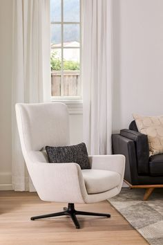 Spacious, elegantly designed, and comfy while still being supportive, the Agga Swivel Chair is the premier destination for curling up with a good book. Or three. #ModernLivingRoom #LoungeChair #HomeInspiration #LivingRoomIdeas Egg Chair, Swivel Chair, Lounge Chairs, Curling, Accent Chairs, Comfy, Living Room, Book, Inspiration