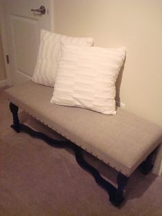 Bench covered in linen fabric with nailhead accent