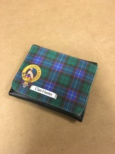 Leather feel wallet with fabric face printed with Hunter clan crest and tartan design