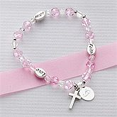 Faith & Love Child's Personalized Bracelet. She will cherish the meaningful sentiments of Faith, Love, and Hope delicately engraved on both sides of the silver plated ovals. Each bracelet is custom engraved on the sterling silver oval medallion with any initial on one side and optional year on the reverse. Beautifully crafted of sparkling crystals, decorative silver-plated spacers and double sided cross charm to add to its appeal. Stretches to accommodate most child's size wrist; ages 3-12…