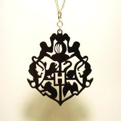 Hogwarts Crest from Harry Potter- Pendant, Keyring, or Zipper Pull -... ($9.50) ❤ liked on Polyvore featuring jewelry, necklaces, harry potter, acrylic jewelry, laser-cut jewelry, pendant necklace, lucite jewelry and acrylic pendants