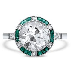 The Tallisa Ring. An intricate halo of french cut emeralds and diamonds encircle a 1.80 carat old European cut diamond in this fantastic platinum Art Deco reproduction (approx. 1.92 total carat weight).