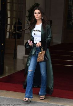 Sensational:Her later ensemble was equally stylish yet contrasting in theme as she rocked the fur trimmed silk duster coat to give her T-shirt and jeans look a touch more drama