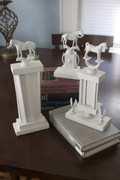 DIY: spray paint old trophies for props