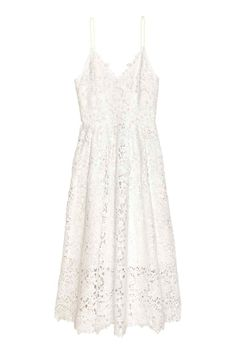 Lace dress: Calf-length lace dress with a V-neck, narrow, adjustable shoulder straps, a concealed zip at the back and a seam at the waist with pleats and a full skirt. Jersey lining.