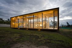 The X House by Arquitectura X takes the rectangular glass home concept and pushes it to a grand scale. X House is a sprawling two-story home with floor-to-ceiling glass across two levels. While its shorter side walls, its ceiling and floors are wood and metal, its front and rear sides are entirely transparent.