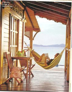 I'd definitely have a hammock on the porch with a view to the sea so I could read my books and daydream and fall into blissful  naps....