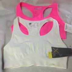 ‼SALE‼️2 BRAND NEW XERSION SPORT BRAS These are new XERSION medium support bras.  They are made of 94% nylon and 6% spandex.  Colors are sizzling pink and white.  The white has a little makeup discoloration around neck hole from trying on as seen in pic 3, but that will come out in wash and I didn't wash as I would have had to take tags off to do  so. Xersion Intimates & Sleepwear Bras