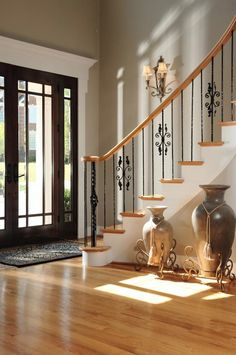 Foyer stairs decor with vases