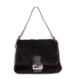 1,450.00 This is an authentic Fendi Mama Forever Hobo. Done in stunning materials this bag combines iridescent glace leather and luxurious mink fur. This bag features silver hardware
