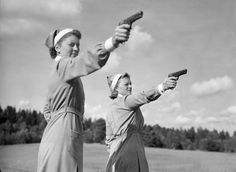 """Sisters of Mercy"" Two women from the Swedish Women's Voluntary Defence Organization (Lottakåren) doing target practicing in"
