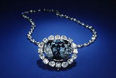 "The Hope Diamond, also known as the Tavernier or French Blue. Most likely from the Kollur mine in Golconda, India. Its color was described by Tavernier as a ""beautiful violet."" Tavernier sold the diamond to King Louis XIV of France in 1668. It is classified as a type IIb diamond. The Hope diamond phosphoresces a strong red color, lasting for several seconds after exposure to short wave ultra-violet light. The diamond's blue coloration is attributed to trace amounts of boron in the stone."