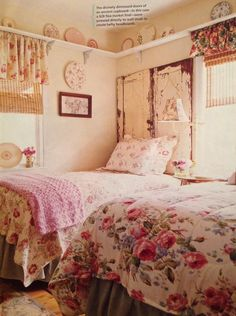 Chippy white paint, faded vintage florals, and a warm palette make up this dream boho cottage bedroom.