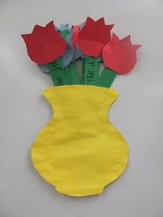The flower stems are coupons for mom to choose from.  There are 8 flowers in all and they come out of the vase. We put a magnet on the back so mom can put it on the refrigerator. It's just construction paper but the kids love making it for mom!