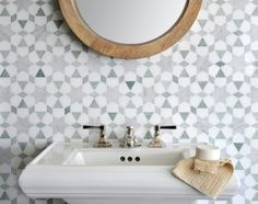 From New Ravenna, quilt-style backsplash mosaic tile featuring Medina, Ming Green and Thassos White.