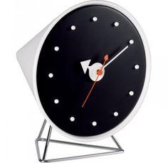 HORLOGE CONE CLOCK  Caractérisées par la diversité des matériaux et des formes, les horloges créées par George Nelson incarnent l'esprit des années 1950. Cette horloge de table reste une alternative pleine de fraîcheur aux objets habituels de mesure du temps. Collection Vitra Design Museum.  Designer :GEORGE NELSON Marque :VITRA Couleur :NOIR Dimensions : L 15cm H 17cm P 15,5cm  #Jbonet #design #Vitra