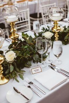 Gold candles & garland lined the tables as centerpieces.