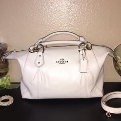 BNWT- Coach purse!  Beautiful bag! Bag includes shoulder strap as seen in last picture! Color is a beautiful ivory, off white color! Perfect color to go with every outfit! Inside it has 1 zipper compartment and 2 open ones. Has complete zipper closure. Hardware is light gold!  Coach Bags