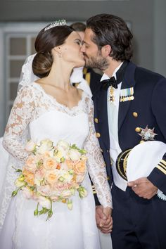 Prince Carl Philip and Princess Sofia Hellqvist, Duchess of Värmland, kissed following their nuptials at the Royal Palace in Stockholm, Sweden, on June 13, 2015.