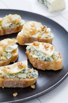 Always a crowd favorite, blue cheese, thinly sliced pear, honey, and chopped walnuts is a classy-ass combo.   - Delish.com