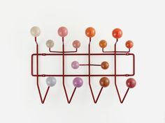 Used instead of simple hooks, the brightly coloured wooden balls of the 'Hang it all' coat rack are aimed at encouraging children to literally hang up all their things.
