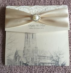 Beautiful wedding invite. Cream and gold. With own church on it.