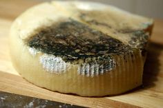 To keep it from getting moldy, Rub the cut edge of cheese with some butter
