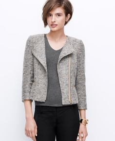 """Styled in simply-must-have tweed with flecks of gorgeous color, this marvelously textured jacket is key for fall. Pair with skinny leggings or a pencil skirt for an of-the-moment look. Jewel neck. 3/4 sleeves. Asymmetrical zip front. Front shoulder yoke. Front besom zipper pockets. Lined. 20"""" long."""