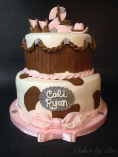 Pink cowgirl themed birthday cake! Cowgirl boots, cowgirl hat, cow print.