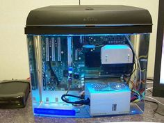 (from 2008) Alan Parekh builds a PC into a fish tank using mineral oil to cool the components (typically cooling a PC involves lots of fans and blowing air across heatsinks and is often quite noisy)