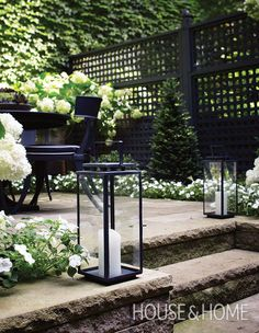 Light the way with lanterns. Lanterns and pillar candles never fail to set the mood at an outdoor dinner party, but they're also a practical addition where light is lacking. Place a matching pair at the top of a set of stairs for a balanced look. | Photographer:Angus Fergusson | Designer:Landscape design, Terry Ryan