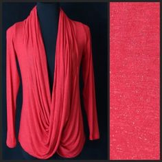 """Red Metallic Glitter Draping Front Long Sleeve Top ‼️PRICE FIRM‼️    Very beautiful top!  Draping cowl front.  Very versatile for year round wear.  Looks great with a turtleneck under it or a tank top (not included).  Beautiful true red color with subtle metallic glitter.  Lots of stretch for a perfect fit.  96% rayon, 4% spandex.  I also have this same top with a lace back.  Please check my closet for many other items.  Bust 40""""-48""""  Length of garment 29"""" Sun & Moon Tops"""