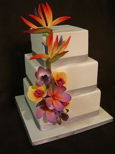 Birds of paradise. Gorgeous. Make the other flowers plumerias or gardenias and hibiscus.