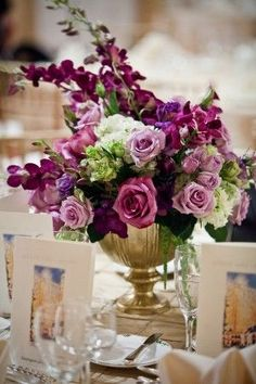 purple royalty reception wedding flowers, wedding decor, wedding flower centerpiece, wedding flower arrangement, add pic source on comment and we will update it. www.myfloweraffair.com can create this beautiful wedding flower look.