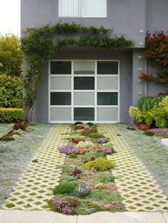 Creeping mint-filled pavers and succulents turn this working driveway into a green entryway in the Nash garden in the Castro neighborhood of S.F.