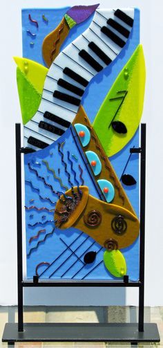 Music 2 collage with saxphone in fused glass by www.hiddenglassstudio.com
