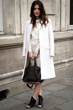 STREET STYLE : All white outfit accessorized with black Givenchy bag and shoes...